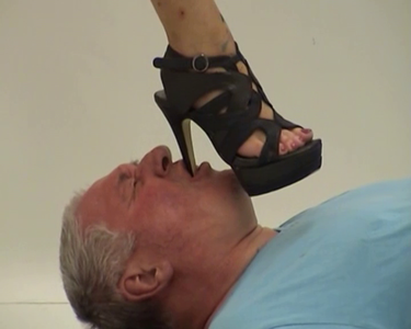 Foot Slave Brutalized by Two Mistresses
